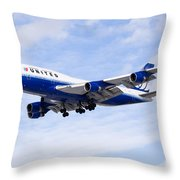 United Airlines Boeing 747 Airplane Flying Throw Pillow by Paul Velgos