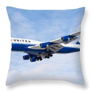 United Airlines Boeing 747 Airplane Landing Throw Pillow by Paul Velgos