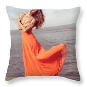 Young Woman In Orange Dress Flying In The Wind At Sea Shore Throw Pillow by Oleksiy Maksymenko