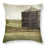 Abandoned wood grain storage bin in Saskatchewan Throw Pillow by Sandra Cunningham