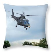 An Agusta A109 Helicopter Throw Pillow by Luc De Jaeger