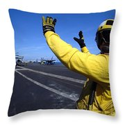 An Aviation Boatswains Mate Directs Throw Pillow by Stocktrek Images