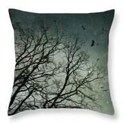 Flock Of Birds Flying Over Bare Wintery Trees Throw Pillow by Sandra Cunningham