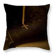 Gold Cross Pendant Resting On A Book Throw Pillow by Philippe Widling