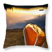 Lake Sunset With Canoe On Beach Throw Pillow by Elena Elisseeva