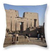 Tourists Walk Towards The Temple Throw Pillow by Taylor S. Kennedy