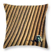 Tractor Plowing A Field Throw Pillow by John Short