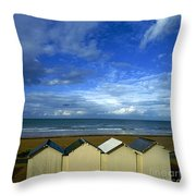 Beach Huts Under A Stormy Sky In Normandy Throw Pillow by Bernard Jaubert