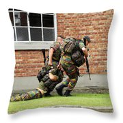 Soldiers Of The Belgian Army Helping Throw Pillow by Luc De Jaeger