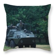The Pandur Recce Vehicle In Use Throw Pillow by Luc De Jaeger