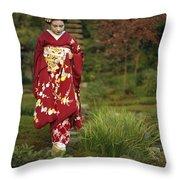 Kimono-clad Geisha In A Park Throw Pillow by Justin Guariglia