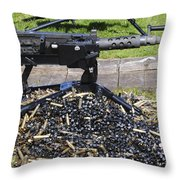 A .50 Caliber Browning Machine Gun Throw Pillow by Andrew Chittock