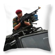 A Belgian Paratrooper Manning A Fn Mag Throw Pillow by Luc De Jaeger