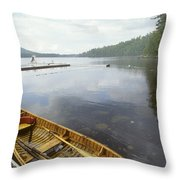A Canoe Floats Next To A Dock Throw Pillow by Skip Brown