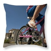 A Child Rides Her Bike Along The Beach Throw Pillow by Stacy Gold