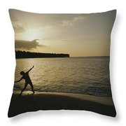 A Child, Silhouetted At Sunset, Throws Throw Pillow by Raul Touzon