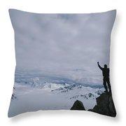 A Climber Raises His Arms In Triumph Throw Pillow by John Burcham