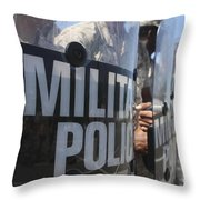 A Close-up View Of Marines Holding Riot Throw Pillow by Stocktrek Images
