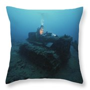 A Diver Inspects A Tractor Dumped Throw Pillow by David Doubilet