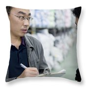 A Factory Employees Discuss Textile Throw Pillow by Justin Guariglia