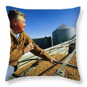 A Farmer Watches As His Corn Is Augered Throw Pillow by Joel Sartore