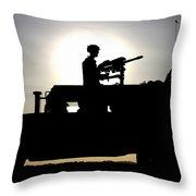 A Gunner Mans An Mk-19 40mm Machine Gun Throw Pillow by Stocktrek Images