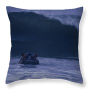 A Hippopotamus Surfs The Waves Throw Pillow by Michael Nichols