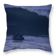 A Hippopotamus Surfs The Waves Throw Pillow by Michael Nichols