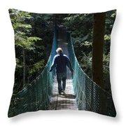A Man Walks Across A Suspension Bridge Throw Pillow by Taylor S. Kennedy