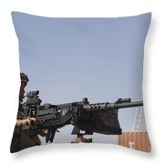 A Royal Marine Manning A .50 Caliber Throw Pillow by Andrew Chittock