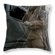 A Scout Observer Applies Camouflage Throw Pillow by Stocktrek Images