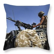 A Soldier Of The British Army Mans Throw Pillow by Andrew Chittock