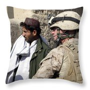 A Soldier Talks To A Local Villager Throw Pillow by Stocktrek Images