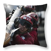 Aviation Ordnancemen Carry An Throw Pillow by Stocktrek Images