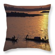 Boats Silhouetted On The Mekong River Throw Pillow by Steve Raymer