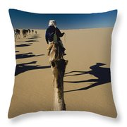 Camel Caravan And Their Shadows Throw Pillow by Carsten Peter