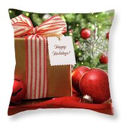 Christmas gift sitting on a table  Throw Pillow by Sandra Cunningham