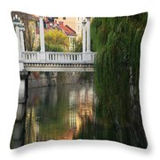 Cobblers Bridge And Morning Reflections In Ljubljana Throw Pillow by Greg Matchick