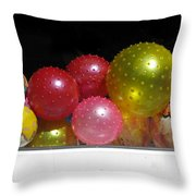 Colorful Balls In The Shop Window Throw Pillow by Ausra Paulauskaite