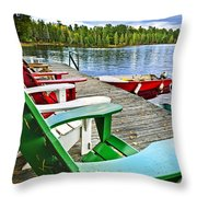 Deck chairs on dock at lake Throw Pillow by Elena Elisseeva