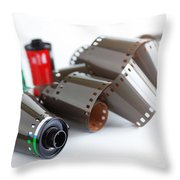 Film And Canisters Throw Pillow by Carlos Caetano
