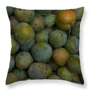 Green Plums Fill A Bin Outside A Local Throw Pillow by Heather Perry