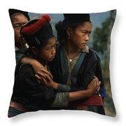 Hmong Girls Cling To Each Other Throw Pillow by W.E. Garrett