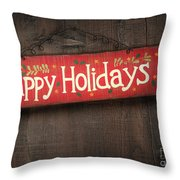 Holiday Sign On Distressed Wood Wall Throw Pillow by Sandra Cunningham