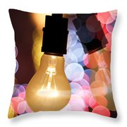 Light Bulb And Bokeh Throw Pillow by Setsiri Silapasuwanchai