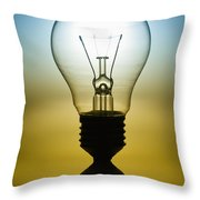 Light Bulb Throw Pillow by Setsiri Silapasuwanchai