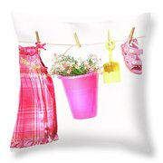 Little Girl Clothes And Toys On A Clothesline Throw Pillow by Sandra Cunningham