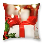 Little Red Ribboned Gift Throw Pillow by Sandra Cunningham