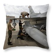 Maintenance Crew Works On Replacing Throw Pillow by HIGH-G Productions
