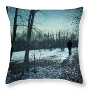 Man walking in snow at winter twilight Throw Pillow by Sandra Cunningham